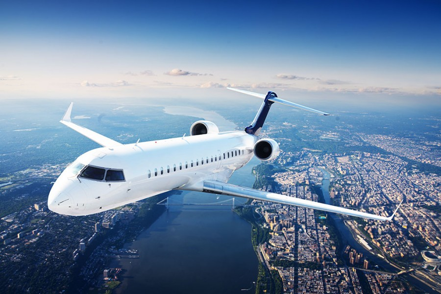 Private-jet-above-city1